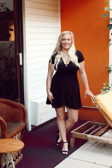 On our bright orange balcony after getting ready for dinner. I wore a little black dress with a strappy bralette and heels.